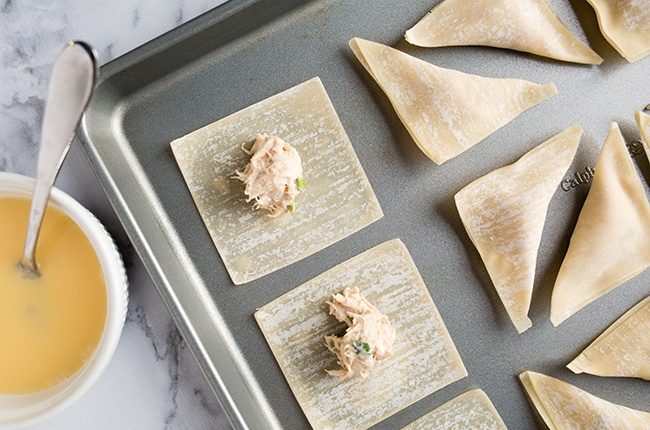 crab ragoons on a cookie sheet