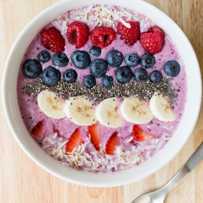 Overhead picture of a large white bowl filled with smoothie and fresh fruit