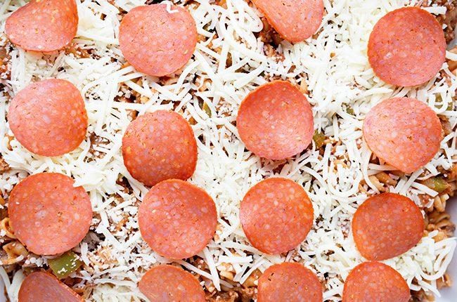 Supreme Pizza Pasta Casserole layering ingredients