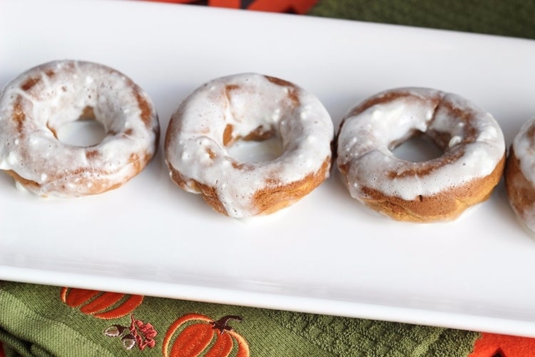 pumpkin donuts on a white plate