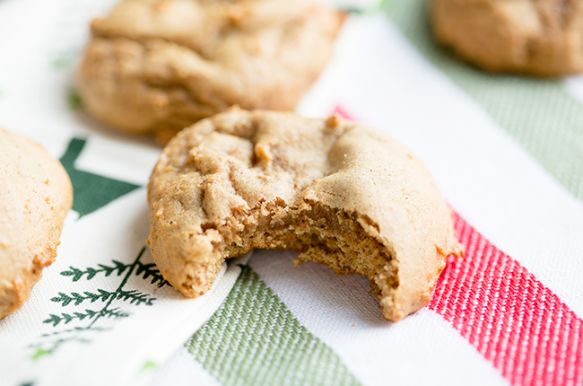Soft gingerbread cookie with a bite taken out of it on a red white and green napkin