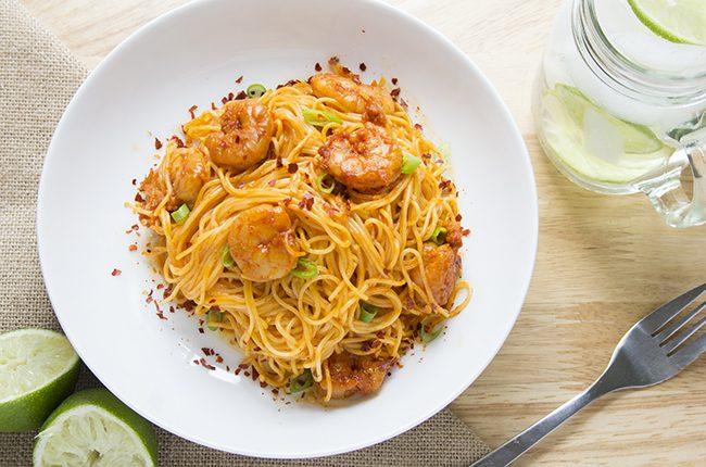 overhead shot of bang bang shrimp pasta on plate