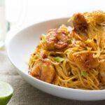 bang bang shrimp pasta in bowl with fork
