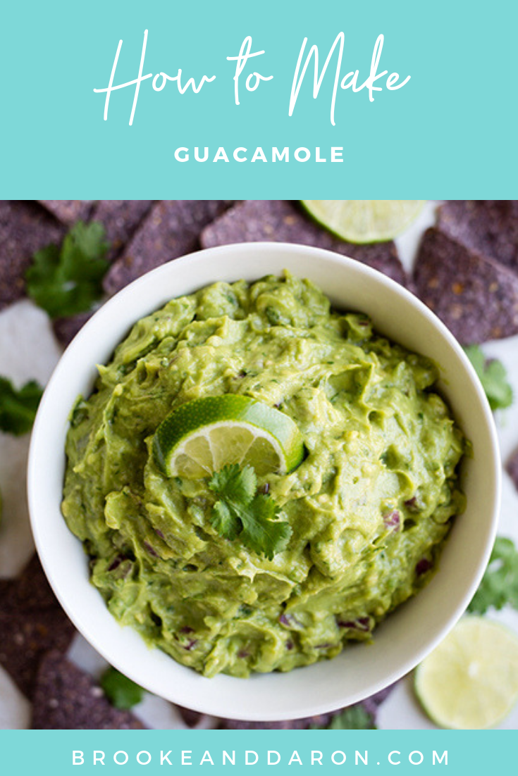 Bowl of homemade guacamole surrounded by tortilla chips