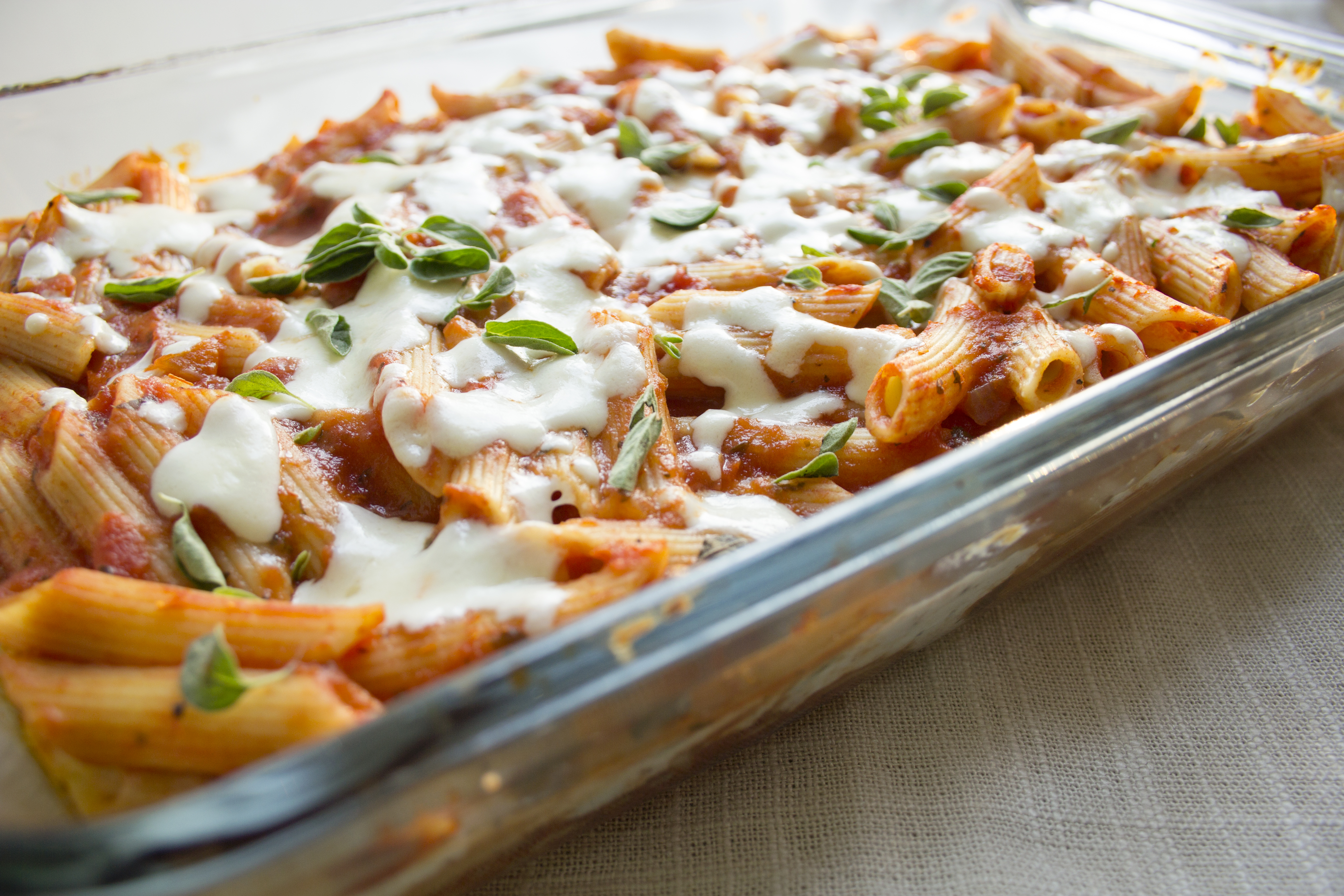 lasagna casserole baked in a casserole dish topped with cheese