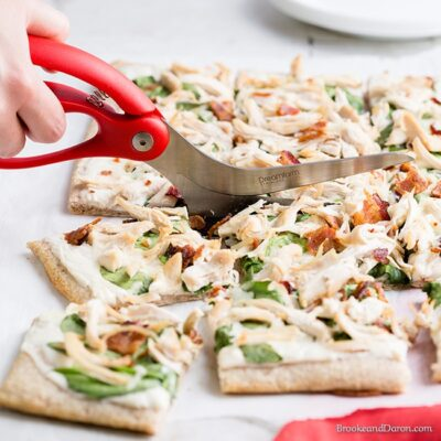 Pizza being cut with pizza shears