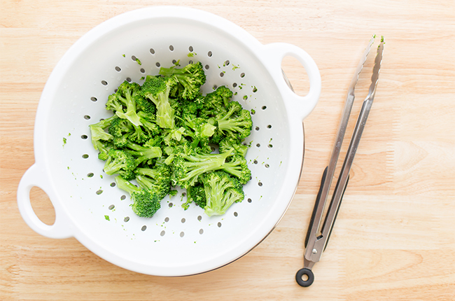 overhead shot of broccoli in strainer for baked broccoli tots recipe