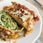 spinach lasagna roll ups on plate