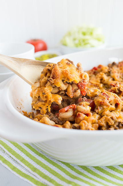 Up close long picture of a spoon of cheeseburger casserole