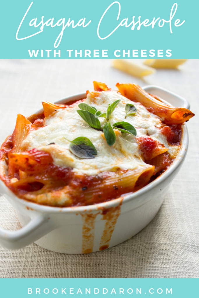 Three cheese lasagna casserole in a white crock for serving