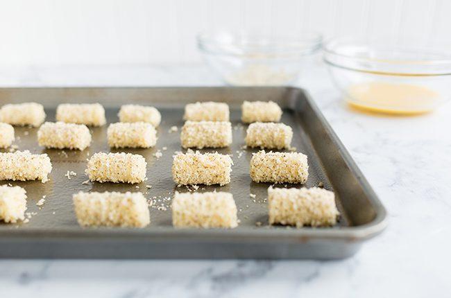 Mozzarella bites sitting on a baking sheet