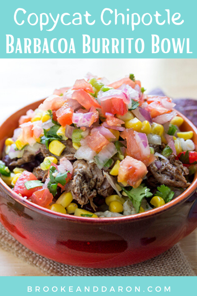 A burrito bowl in a red bowl topped with pico de galo