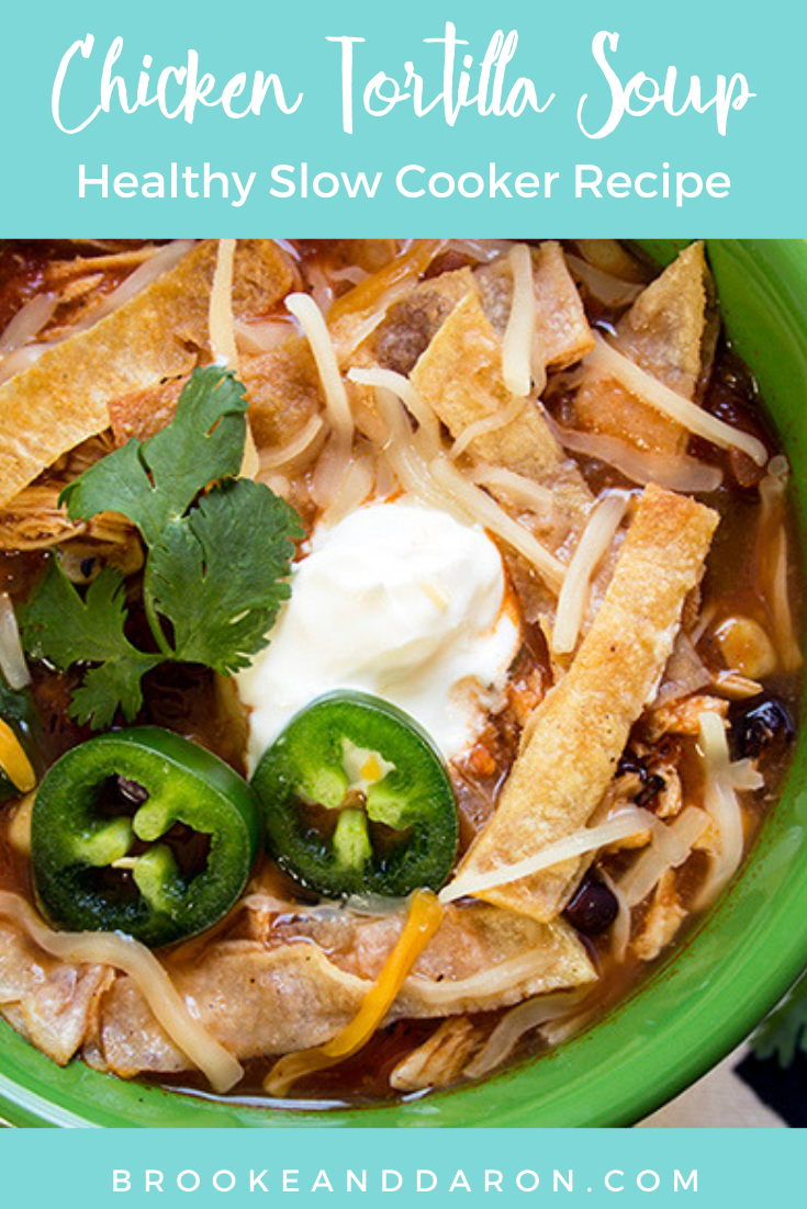 Close up of a bowl of tortilla soup with jalapeno and sour cream