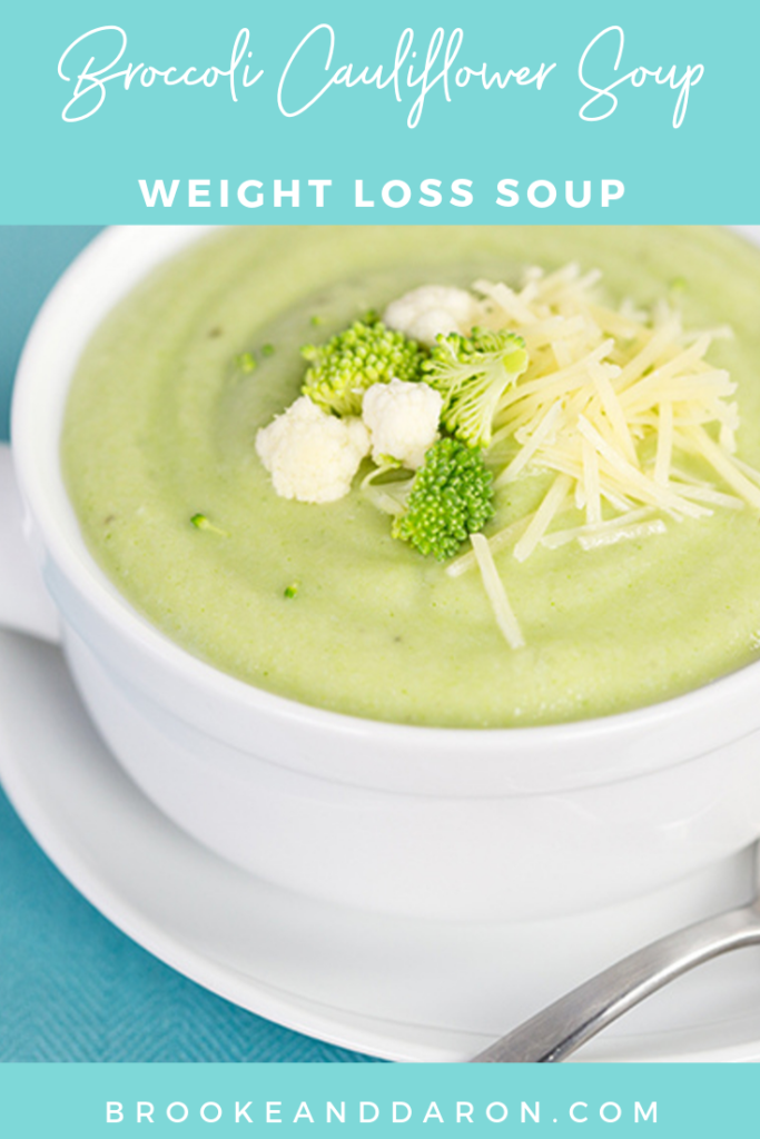Close up picture of broccoli and cauliflower soup in a white soup bowl
