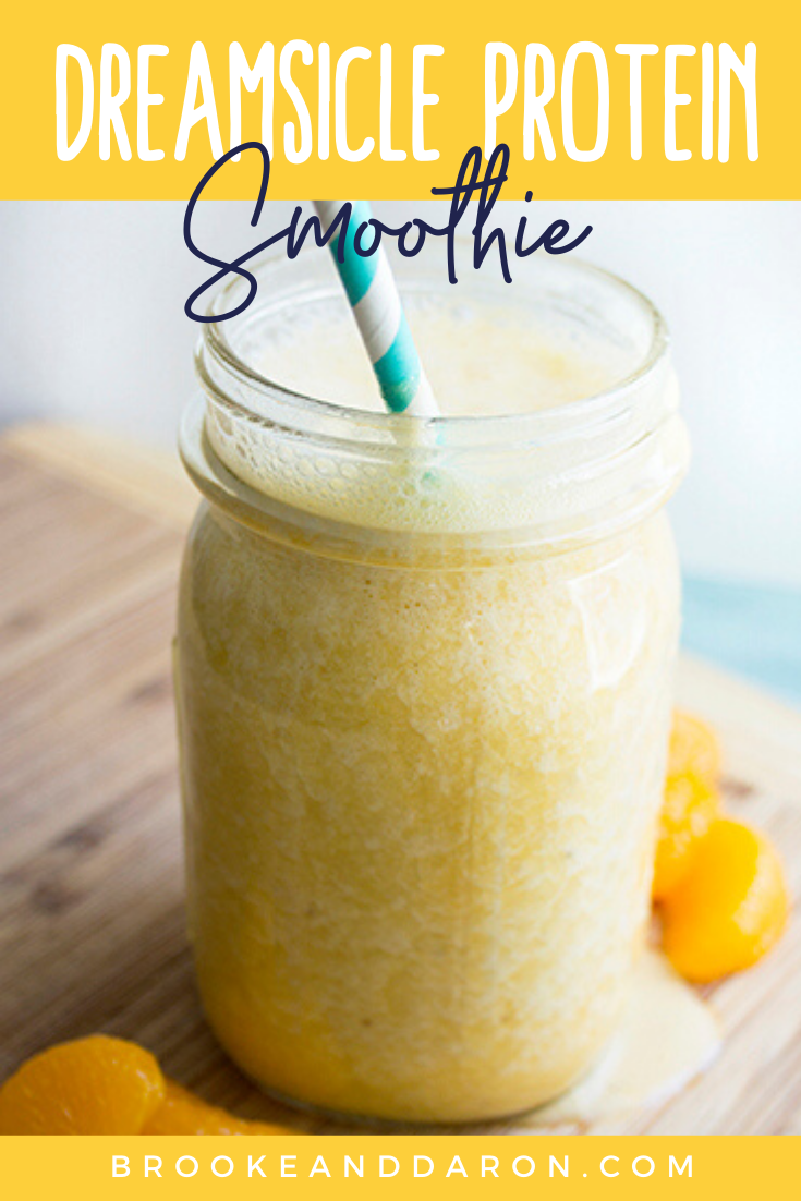 Dreamsicle orange banana smoothie in mason jar with straw