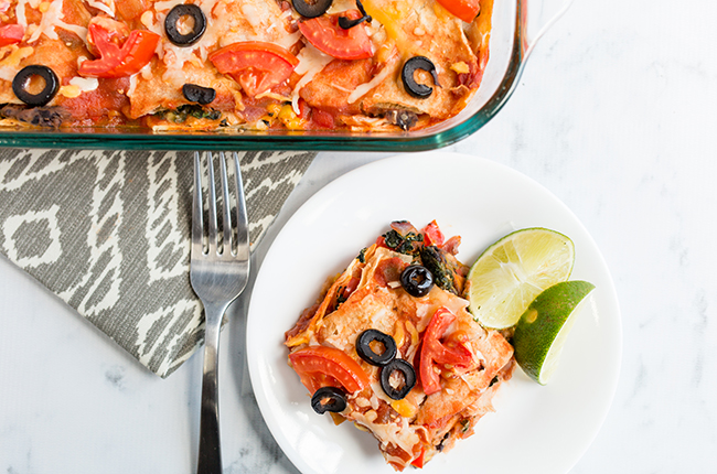 Overhead pictuer of a serving of mexican lasagna on white plate