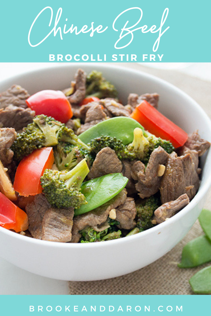 Up close picture of a chinese beef stir fry in a large white bowl