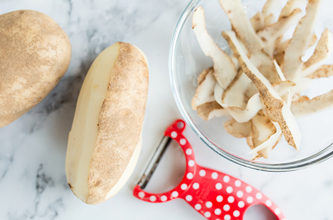Peeling potatoes to make the best shepherds pie