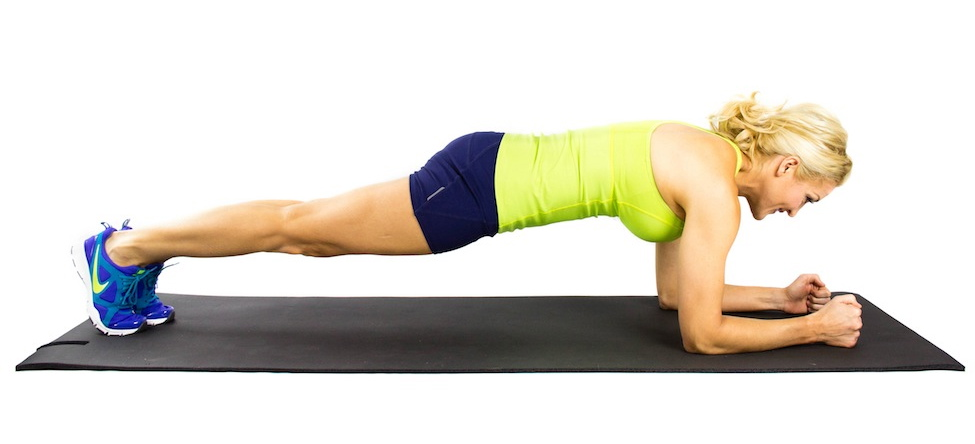 girl doing a forearm plank in beginner ab workout plan