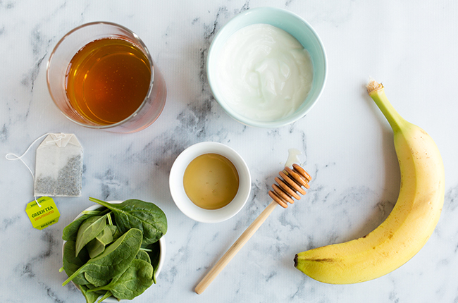 Ingredients for green tea smoothie on marble counter