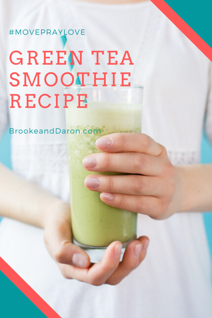 Woman in white dress holding green smoothie